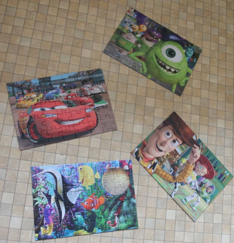 Jumbo Games Disney Pixar 4-in-1 Jigsaw Puzzles