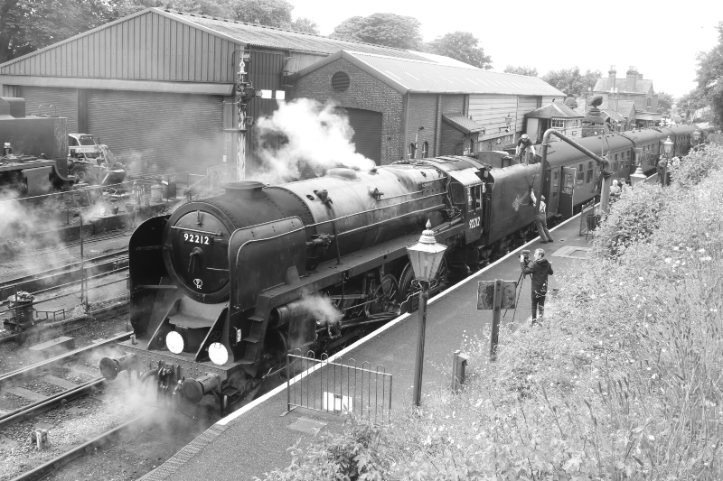 steam locomotive in black and whte