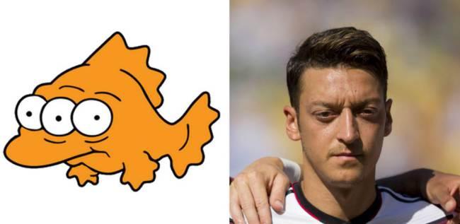Blinky and Mesut Ozil of Germany