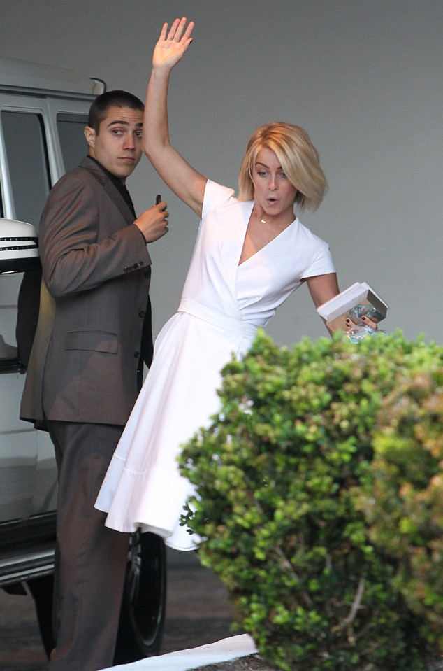 Julianne Hough almost fell while walking, but still managed to wave at the cameras as she arrived to attend Fergie's baby shower held at the SLS Hotel in Los Angeles