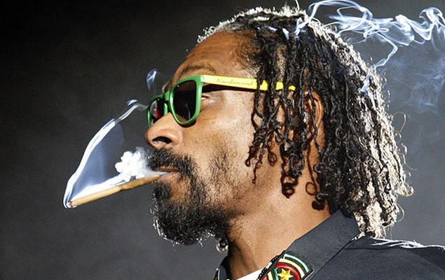Snoop Dogg smokes while performing at the 2012 Coachella