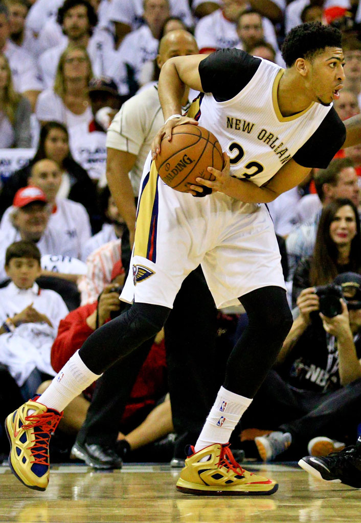 Apr 25, 2015; New Orleans, LA, USA; New Orleans Pelicans forward Anthony Davis (23) is defended by Golden State Warriors forward Draymond Green (23) during the first quarter in game four of the first round of the NBA Playoffs at the Smoothie King Center. Mandatory Credit: Derick E. Hingle-USA TODAY Sports
