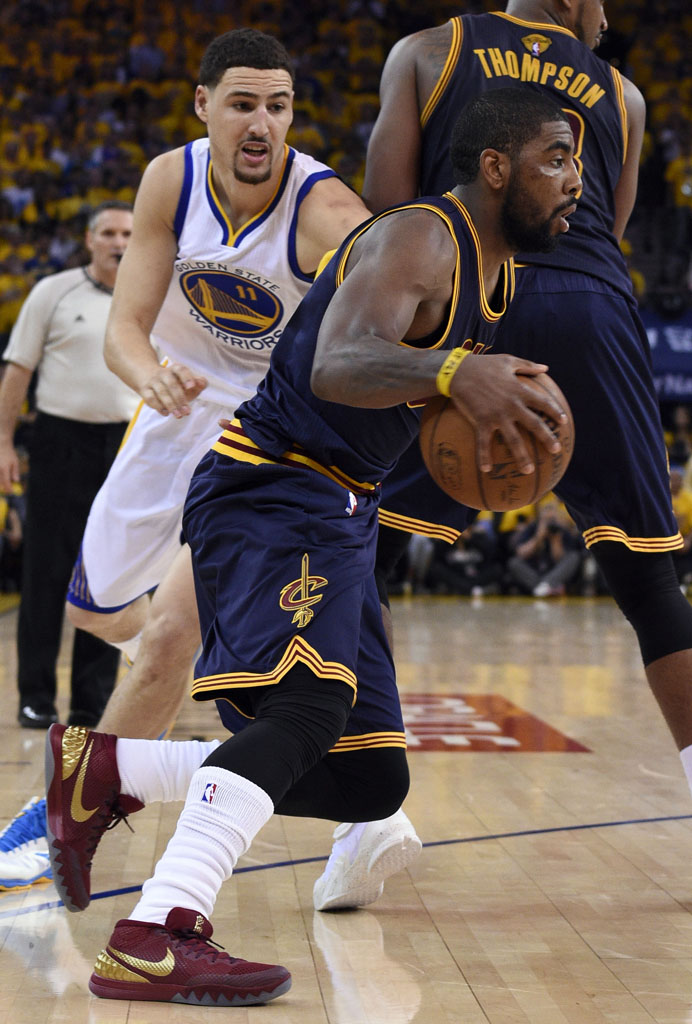 Jun 4, 2015; Oakland, CA, USA; Cleveland Cavaliers guard Kyrie Irving (2) drives to the basket against Golden State Warriors guard Klay Thompson (11) during the second quarter in game one of the NBA Finals at Oracle Arena. Mandatory Credit: Kyle Terada-USA TODAY Sports