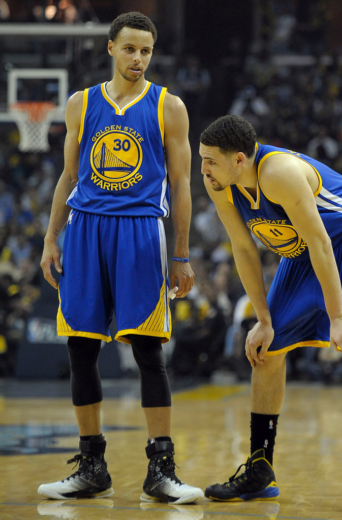 May 9, 2015; Memphis, TN, USA; Golden State Warriors guard Stephen Curry (30) and Golden State Warriors guard Klay Thompson (11) during the game against the Memphis Grizzlies in game three of the second round of the NBA Playoffs at FedExForum. Mandatory Credit: Justin Ford-USA TODAY Sports