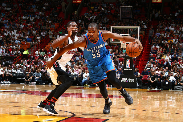 MIAMI, FL - DECEMBER 3: Kevin Durant #35 of the Oklahoma City Thunder handles the ball against the Miami Heat on December 3, 2015 at AmericanAirlines Arena in Miami, Florida. NOTE TO USER: User expressly acknowledges and agrees that, by downloading and or using this Photograph, user is consenting to the terms and conditions of the Getty Images License Agreement. Mandatory Copyright Notice: Copyright 2015 NBAE (Photo by Nathaniel S. Butler/NBAE via Getty Images)