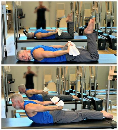 Mature male athlete doing chest opener stretch using towel.