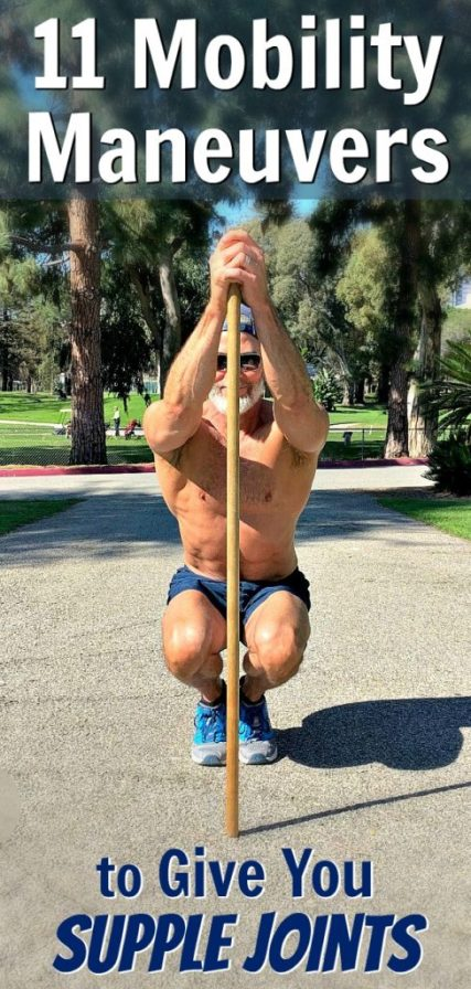 An over-50 athlete using a pole to do mobility ankle squats.