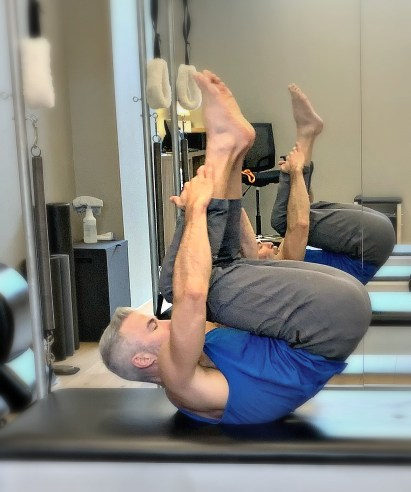 Man doing tumbling calisthenics for improved strength and conditioning.