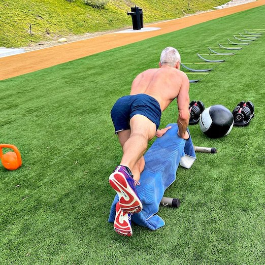 Male athlete does outdoor exercise to strengthen his glute muscles.