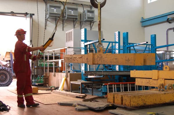 Operating crane in previous Edmonton warehouse.