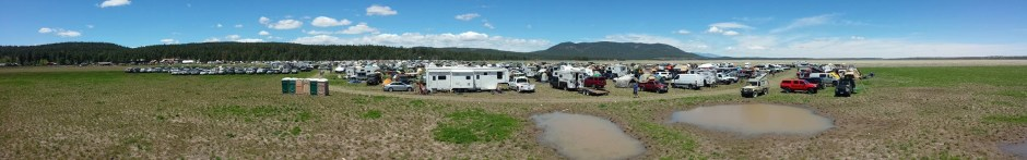 View of our portion of the campground. Panorama of the mountain lake bed with campers clustered in the middle