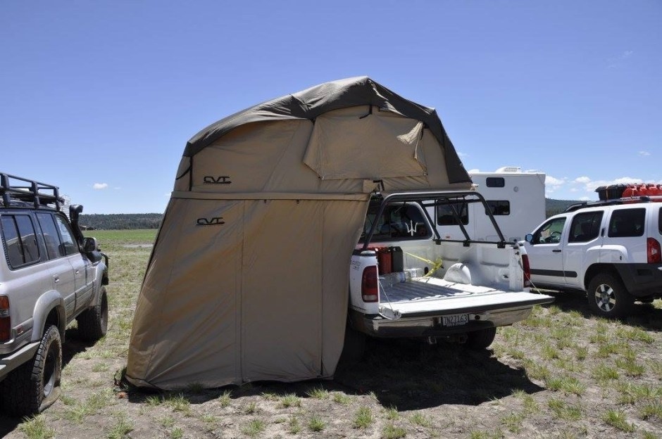 White Ford truck with rooftop tent