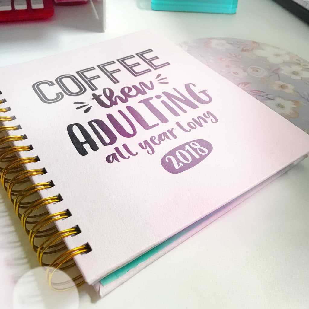 """A photo of my planner, which says """"Coffee then adulting all year long""""."""
