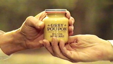 Photo of Why Do So Many Rap Songs Mention Grey Poupon Mustard? [Podcast]