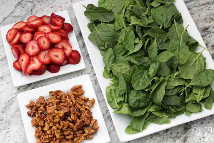 Strawberry Spinach Salad - this is generally crowd favorite and so pretty to look at! | www.overthebigmoon.com