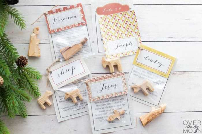Nativity pieces, scriptures and bag toppers on a tabletop.