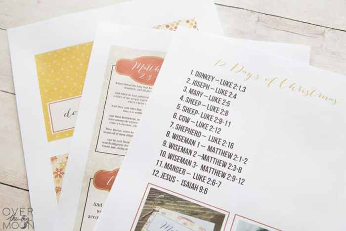 Printed 12 Days of Christmas Nativity printables uncut and laying on a white tabletop.