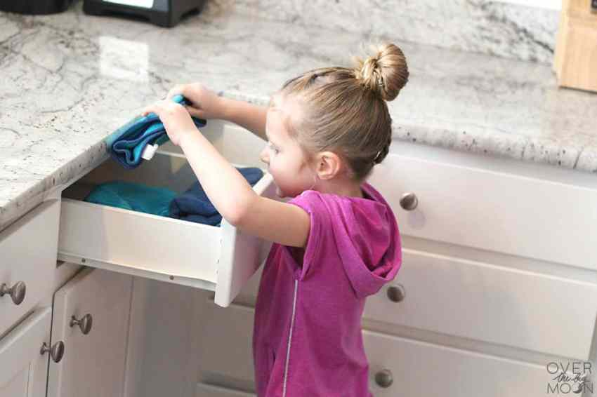 Having toddlers help with Laundry is easy and such a great habit to teach them! Come check out these great Laundry Tips for Families! From overthebigmoon.com! #chores #laundry