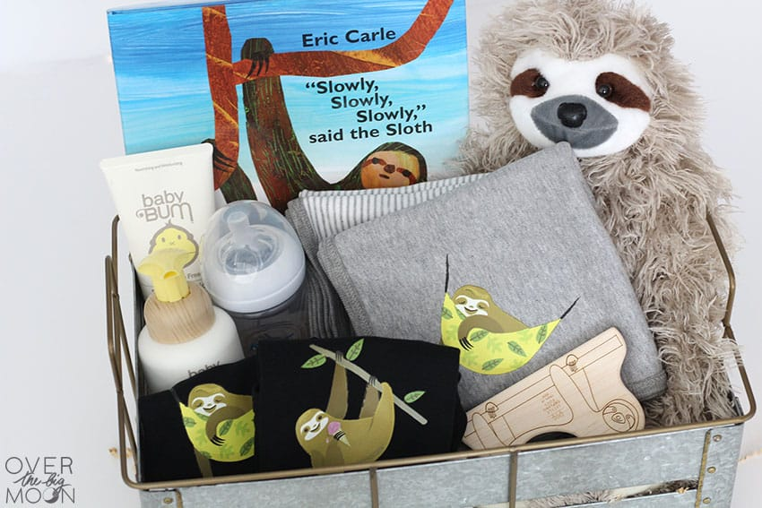 343aaac89 This fun Sloth Themed Baby Gift Idea is so adorable and can be perfect  customized for a boy or a girl! What mama to be wouldn't love receiving  this adorable ...