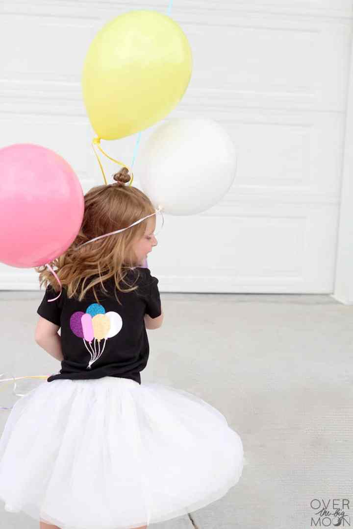 How to make a cute birthday shirt design for your little one using Glitter Iron On and Holographic Iron On! From overthebigmoon.com!