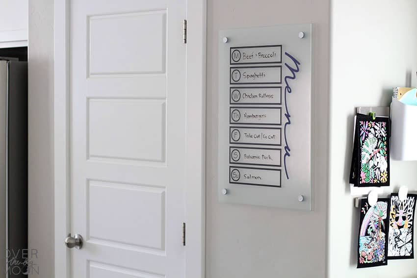 An Easy DIY Menu Board made with my Cricut machine! Perfect decoration and helps you remember what you're making for dinner! From overthebigmoon.com!