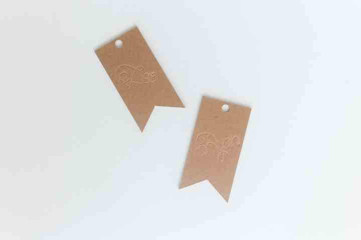 Your Cricut scoring wheel is the perfect engraving tool and I show you how with this engraved chipboard gift tags tutorial! From overthebigmoon.com!