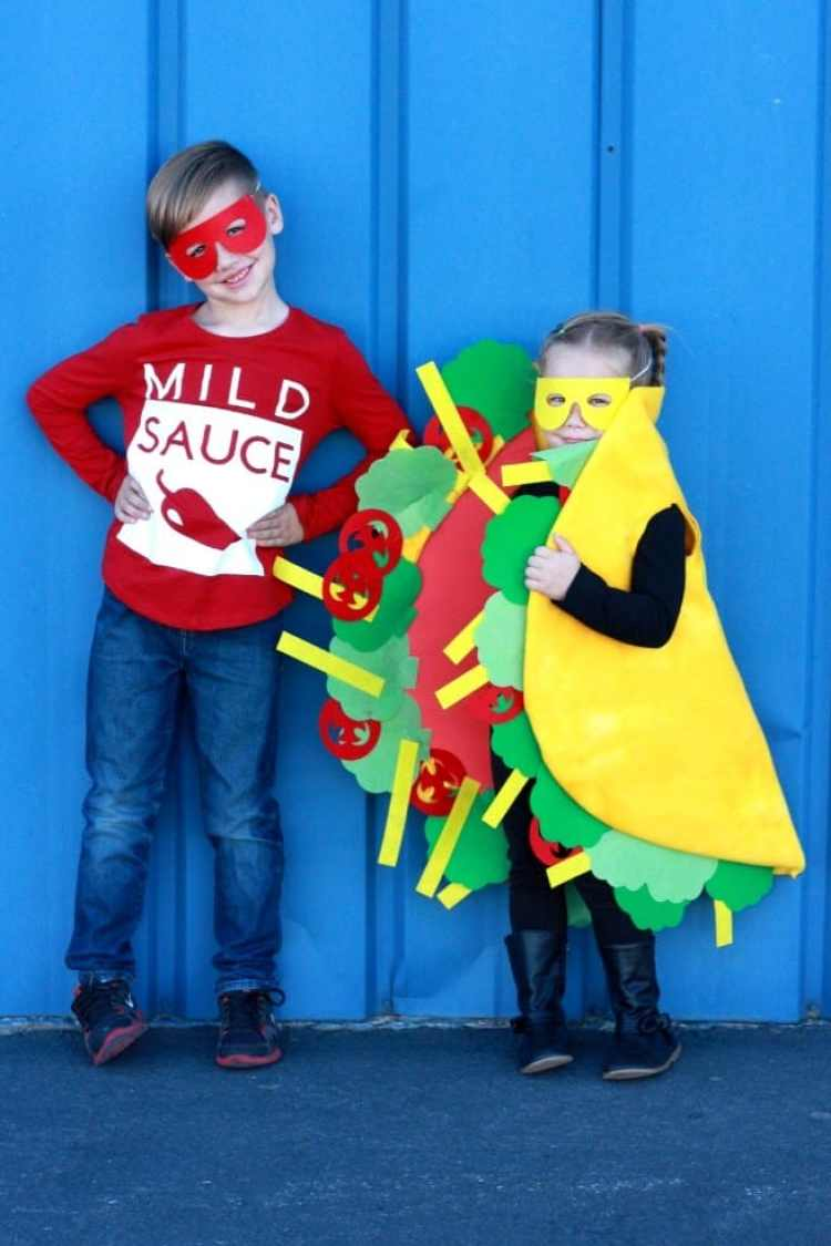 A little boy dressed up as Mild Sauce and a little girl dressed up as a taco!