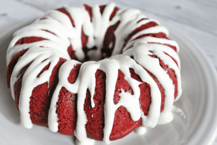 Red Velvet Bundt Cake made in the Instant Pot drizzled with white icing.