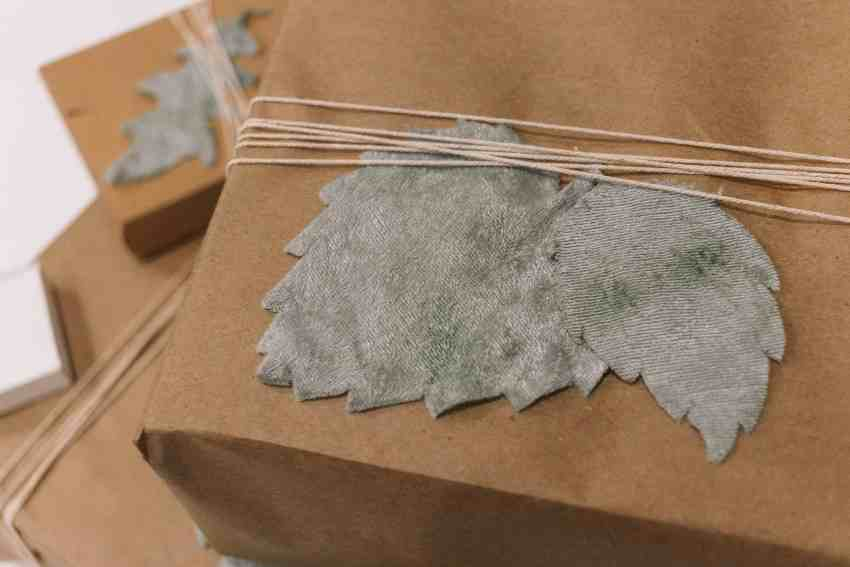 Add a touch of velvet to your gift wrapping with these DIY Velvet Leaf Gift Toppers using a Cricut Maker for a luxe look on your gift!