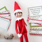 Elf on the Shelf with blank cards to the left and printable Good Deed Cards on the right of the Elf