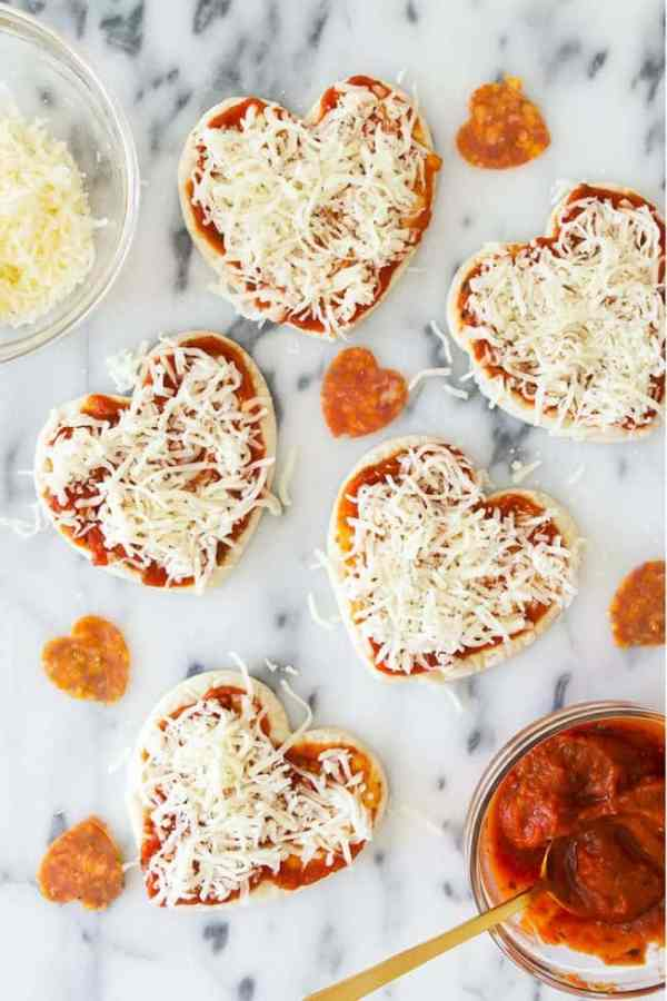 Mini Heart Shaped Pizzas - such a fun Valentine's Day Lunch or Dinner idea! From overthebigmoon.com!