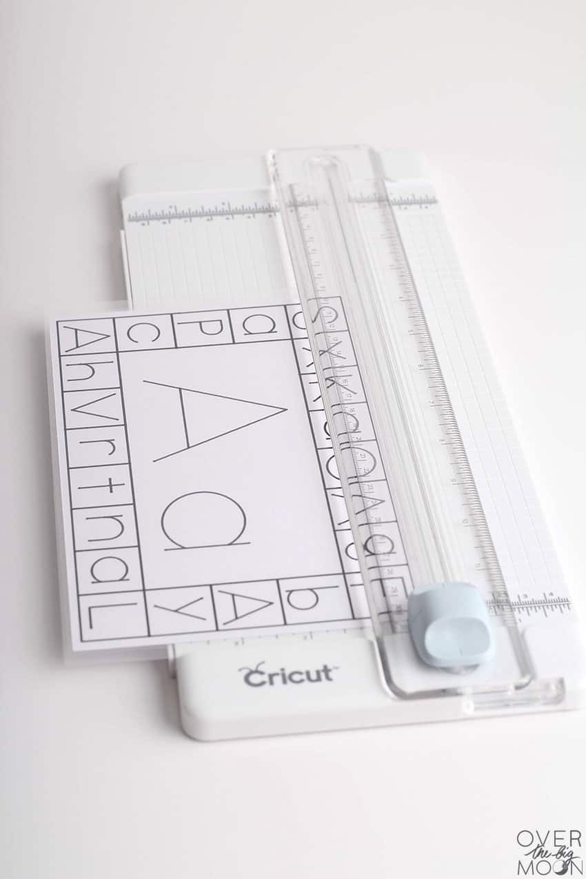 Cut the laminated ABC Card with the Cricut trimmer.
