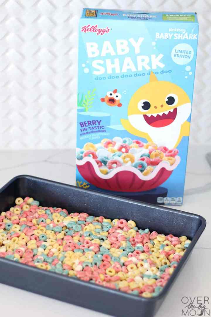 A pan of Baby Shark Cereal Bars, along with the box of Baby Shark Cereal.