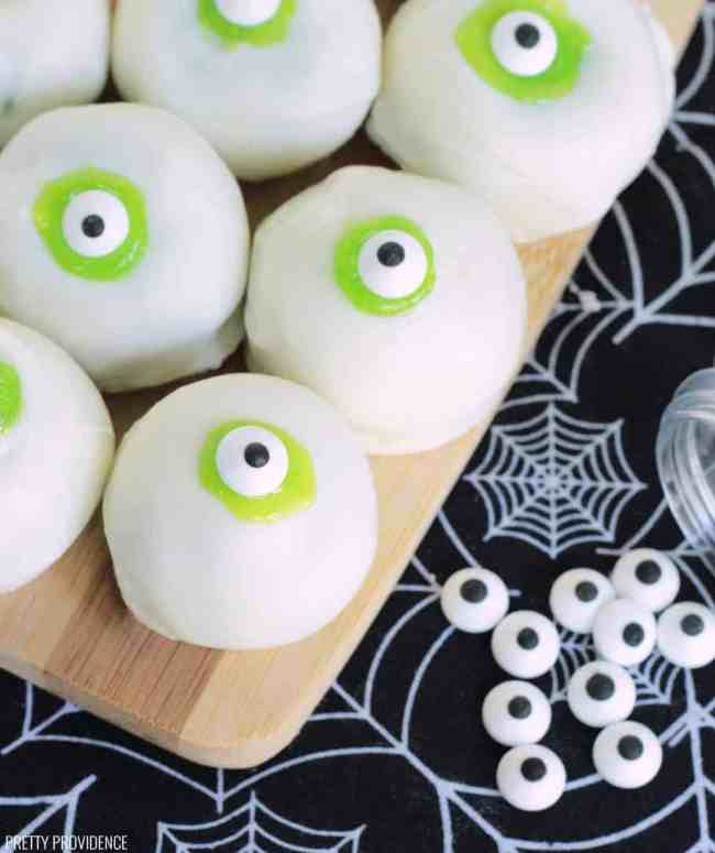 Cake Bites covered in white chocolate and candies to look like eyeballs.