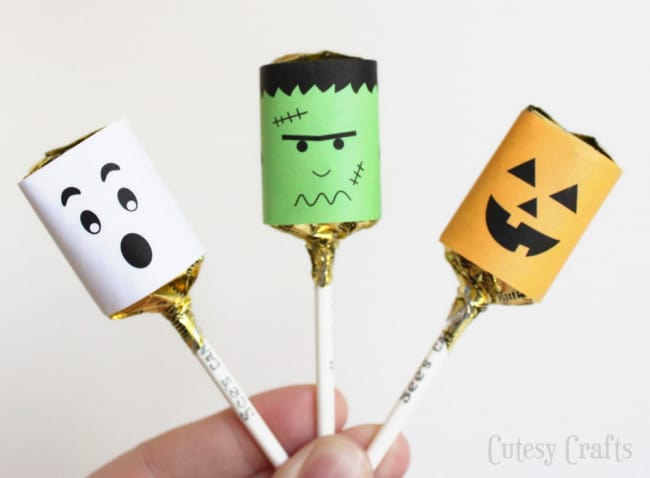 Caramel suckers with fun paper wrappers on them to look like a ghost, Frankenstein and a Pumpkin!