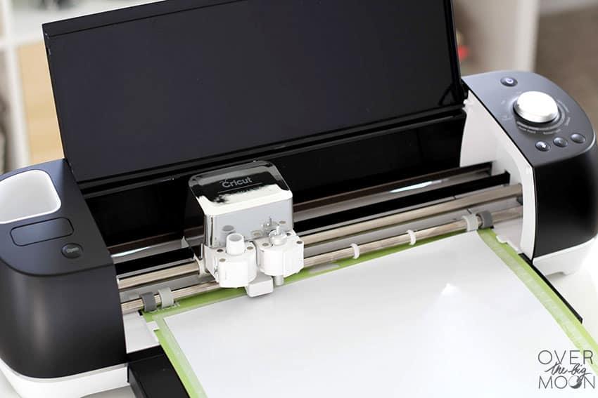 A Matte Black Explore Air 2 machine cutting white SportFlex Iron On!