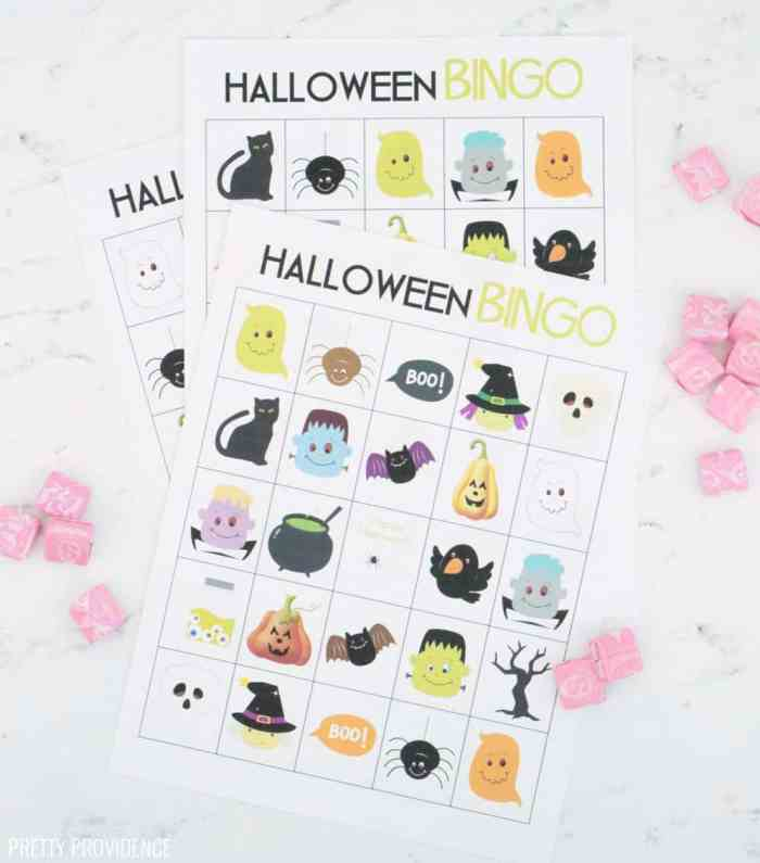 3 printed Halloween Bingo Cards, surrounded by pink Starbursts.