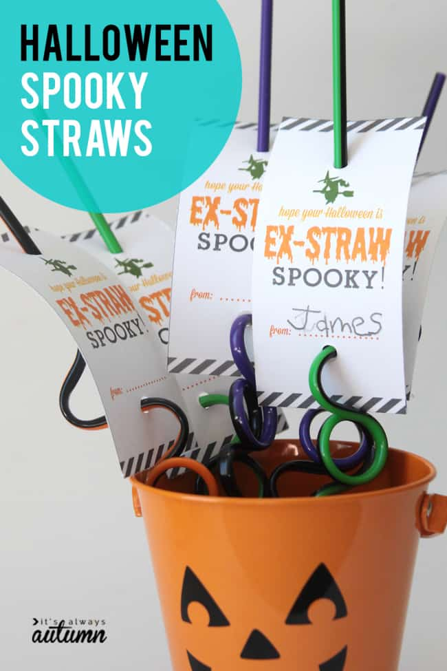 An orange bucket with a pumpkin face on it, filled with twisty straws. The straws have fun tags on them that read Ex-Straw Spooky on them.!
