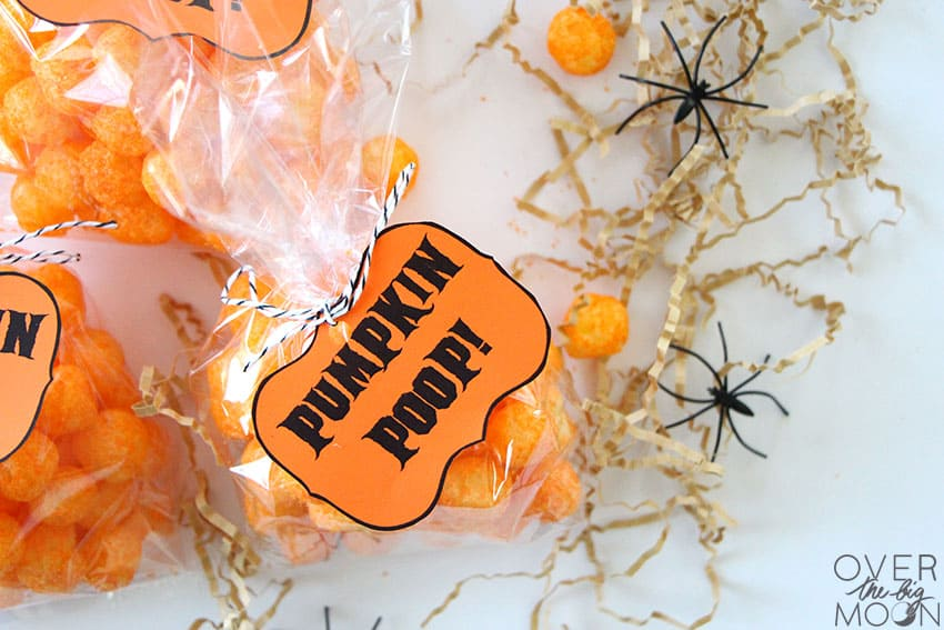 A couple bags of Cheetos Balls with Pumpkin Poop tags attached.