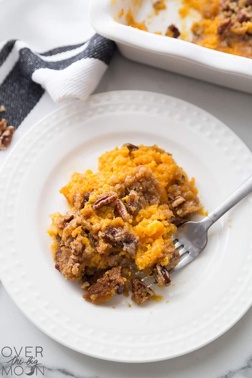 A plate full of Sweet Potato Crunch Casserole - highlighting the Pecan crumble top.