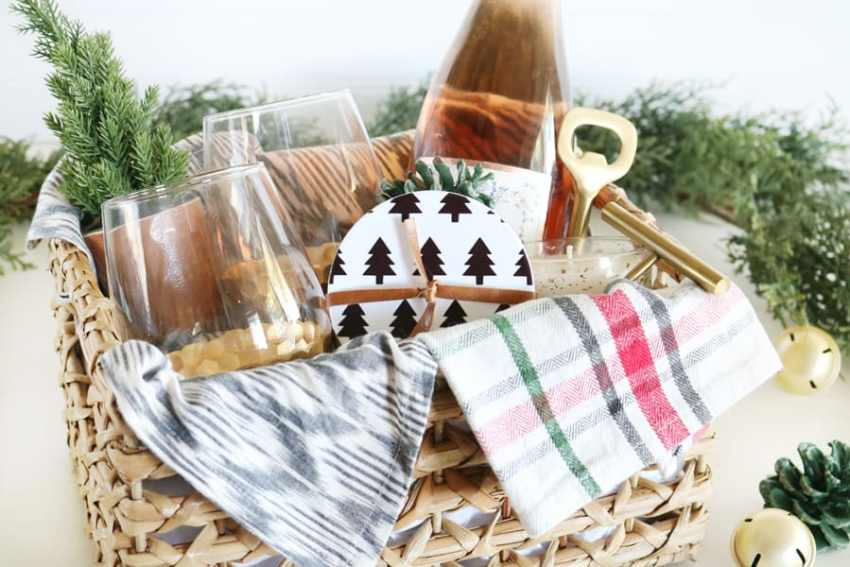 Gift basket full of wine related items, along with some personalized black and white Infusible Ink Coasters.