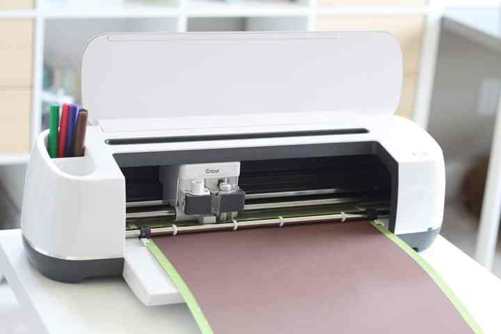 The Cricut Maker cutting Infusible Ink.