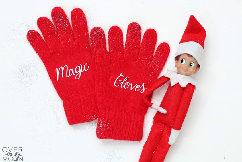 Red Elf Magic Gloves with the Elf on the Shelf off to the right.