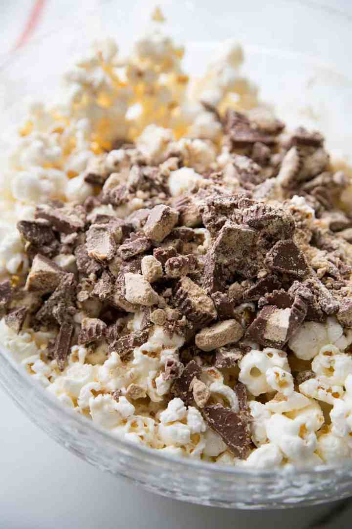 Chopped peanut butter cups added to the white almond bark and popcorn mixture.