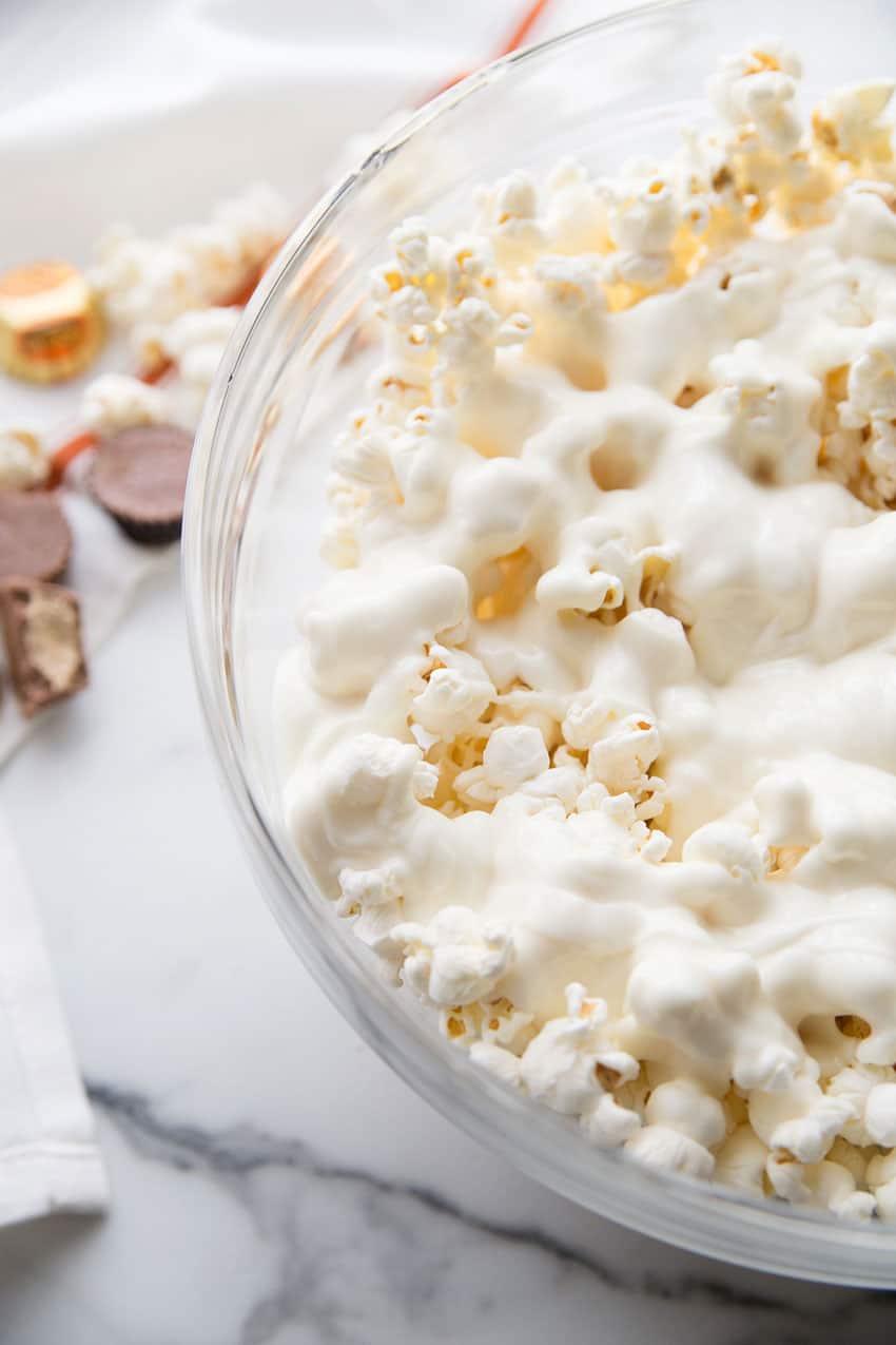 White Almond Bark poured over the popcorn.