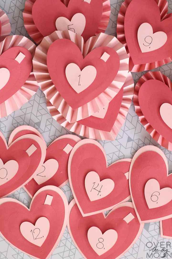 14 Hearts all filled with reasons you love someone. 7 of the hearts are just flat layered hearts and 7 have a rosette heart background. All are numbered from one to fourteen.