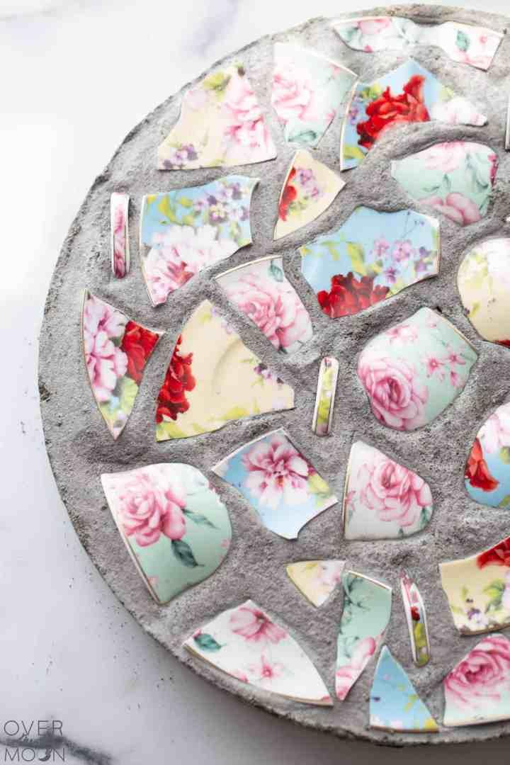 A garden stone made using broken china.