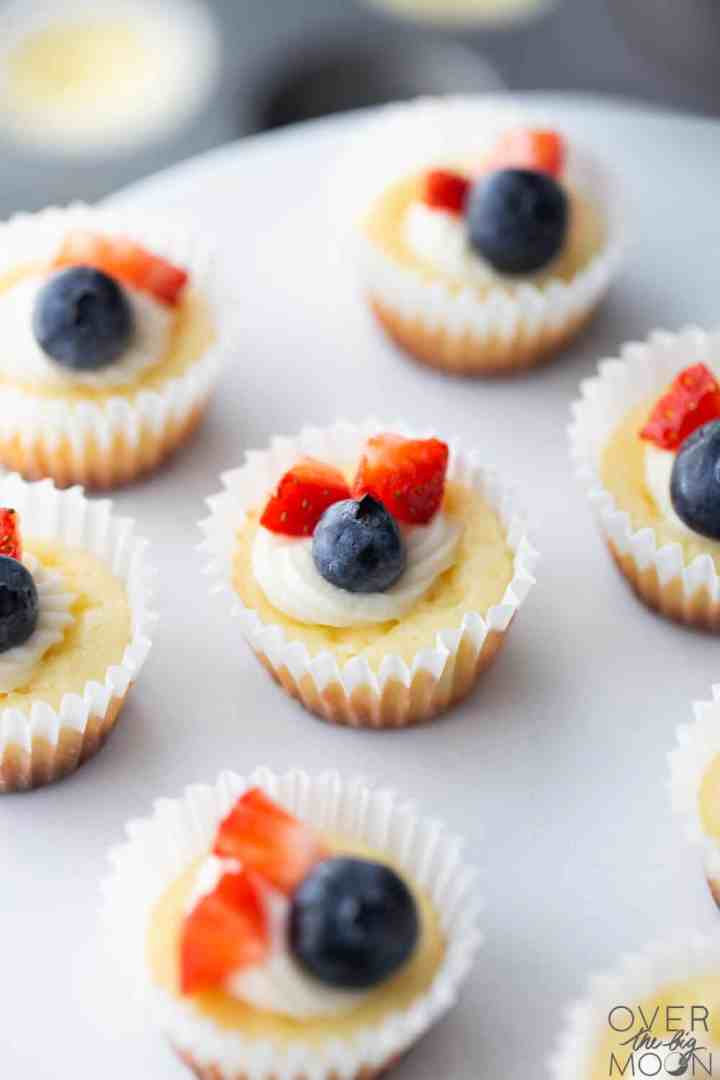 Red White and Blue Mini Cheesecakes using cut up strawberries, raspberries and blueberries.