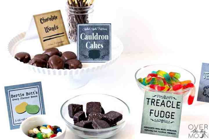 A food table with candy from the Harry Potter books and movies, with coordinating food tags.