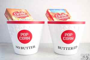 Washable Popcorn buckets with the words Buttered and No Butter on them and boxes of microwave popcorn in them.